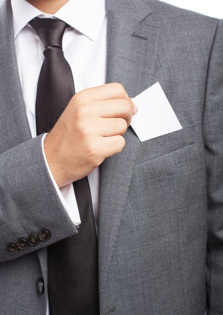 close-up-of-businessman-s-hand-taking-a-blank-card_1149-946