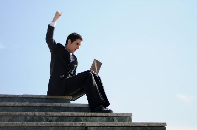 businessman-celebrating-his-success_1139-119